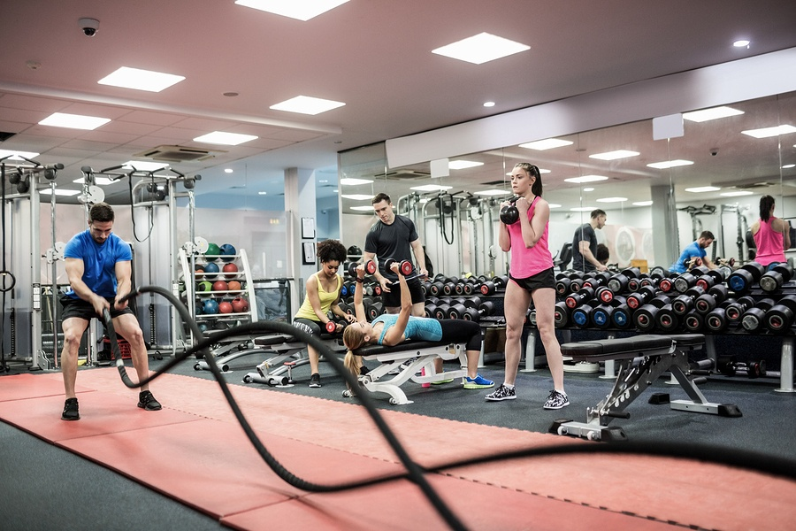 Fit-people-working-out-in-weight-room.jpg